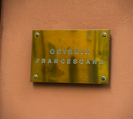 The name plate on the wall of Osteria Francescana