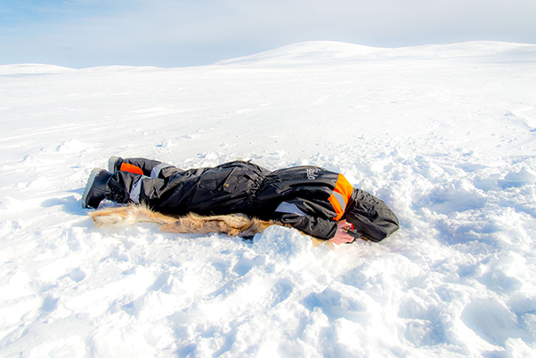 Nick Harman fishing on a frozen lake in Sweden