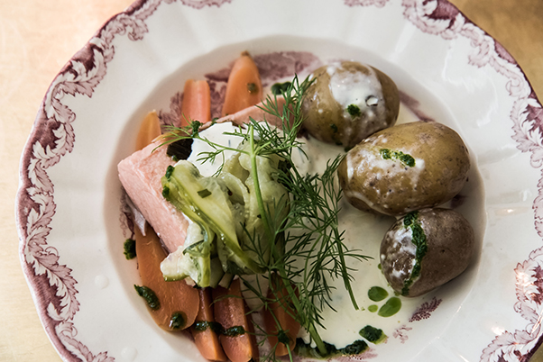 a dish of salmon, potato, carrot and dill at Lilla Saluhallen